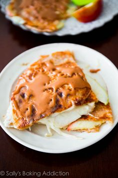 """Caramel Apple Brie Quesadillas - an easy 20 minute recipe. Extra crispy & cheesy! Gooey brie quesadillas stuffed with thinly sliced apples and topped with an easy 2-ingredient caramel sauce. These are the perfect """"anytime"""" food."""