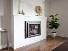 Love It Or List It Vancouver: Mary & Calvin. New gas insert from Valour Fireplaces, refinished with gorgeous Dekton veined white marble slab by Cosentino!!