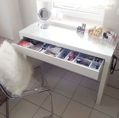pretty makeup space! I'm sure my husband would appreciate a way to hide the makeup.