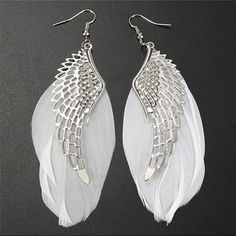 Angel Wings Earrings✨10 available✨ Pretty silver toned zinc alloy earrings. Pretty angel wings and white feathers. Size of feathers may not be exactly the same length due to them being actual feathers. Very pretty earrings! New in clear package. Light weight! Jewelry Earrings