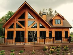 A gorgeous Labrador, from Timber Block's Classic Series. Here's a tidbit for those who love a classic-looking log home, but don't want the hassle and maintenance of most traditionally built log home? Did you know, thanks to Timber Block's patented, panelized home building system, and our ability to dry our wood to an 8-10 percent moisture content, our homes will never settle or check? Imagine...no caulking, no chinking! More on Timber Block's technology at www.timberblock.com.