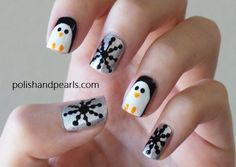 Snow Penguin Nails. I think I would do snowflakes on the other nails instead of the dots..