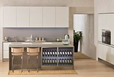 Laevia combines ease of use and functionality with timeless attractive design. Laevia with door in white Satin laminate, Orizzonte handle and Satin Titan finish worktops. Combined with 60 cm tall wall units, this kitchen features an extremely useful, made-to-measure lighting profile in stainless steel finish, while the island has an under-top Wine Rack. #Kitchen Laevia #Arclinea #interiordesign #design