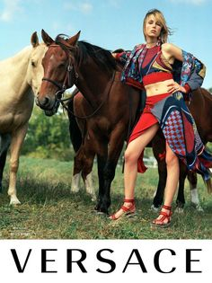 Edie Campbell poses next to a horse in Versace's spring 2017 campaign