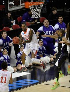 (Scott Sommerdorf   |  The Salt Lake Tribune)  Utah guard Delon Wright (55) passes to Utah guard Brandon Taylor (11) after driving the baseline during first half play. Utah held a 26-19 lead over Stephen F. Austin at the half at the Moda Center in Portland, Thursday, March 19, 2015.