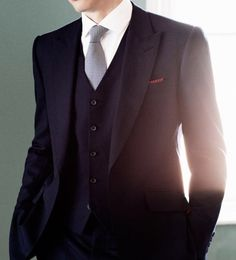 A properly buttoned three piece suit. It's so refreshing to see. Almost no one including adds get it right.