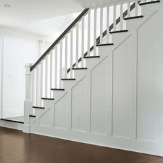 Photo: David Prince   thisoldhouse.com   from Before and After Cape Cod - redone staircase - opened up from a closed wall stair case.