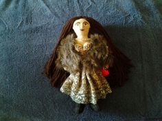 My beautiful doll. Made of felt and recycled materials.