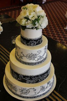 "And here is the extravagant wedding cake to go with your Spanish grandezza theme: adorned with black lace and maybe with red Baccara roses on top instead of the pristine white… for the ultimate WOW effect! More wedding cake ideas on Weddingwoof.com - look up ""cakes"" and find Cake Coquette for your cake dreams come true!"