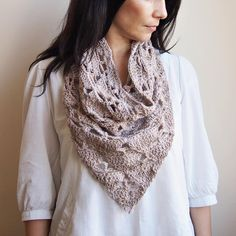 Beautiful beige shawl pattern available at LoveCrochet.Com. The perfect project to wear as a light shawl or scarf over the summer.