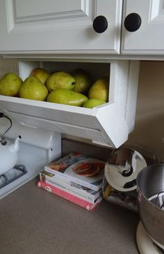 Under-Cabinet Fruit Bin. This is a great use of a wine crate and leftover pallet wood.