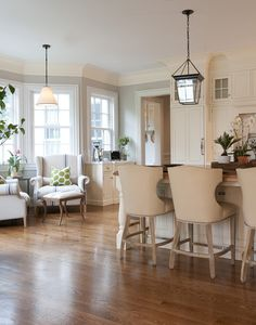 Kitchen Design - love the idea of placing two comfortable chairs in the breakfast nook instead of a table.