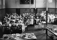 Nurses at St Bartholomews Hospital at lunch in the dining hall.