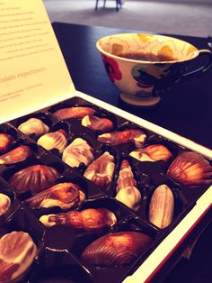 Guylian chocolate truffles and a cup of black coffee. You Kyung Koo.