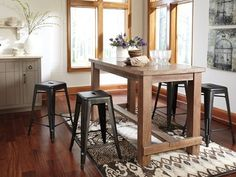 Tables and some stool accents made with select pine veneers and solids in vintage wire brushed gray brown color. Stool frames made from tubular, stamped sheet and solid bar metal with a gun metal finish.