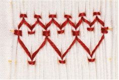 In honor of Valentine's Day, we're sharing this simple smocked heart tutorial.