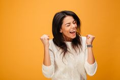 Buy Portrait of an excited young woman celebrating success by vadymvdrobot on PhotoDune. Portrait of an excited young woman celebrating success isolated over yellow background Coping With Divorce, Curly Afro Hair, Long Dark Hair, Woman Smile, Trendy Girl, Confident Woman, Happy Women, African American Women, Young And Beautiful