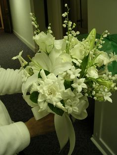 Wedding Flowers - An all white Bride's bouquet of Lily-of-the-valley, Gardenias, Stephanotis, and lilies. Available in a variety of sizes starting at $250.00.
