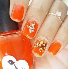 Orange flower nailart #mani #floral #nailcharm