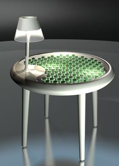 a 'moss table' that generates its own electricity for a built-in light. Biophotovoltaics by Alex Driver and Carlos Peralta