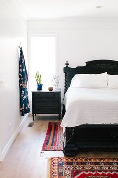 light floors work with dark wood bed and nightside since everything else is white or ethnic prints