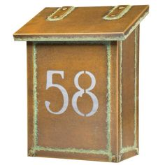 null Tie together your stylish porch ensemble with this timeless mailbox, featuring a wall-mounted design. Finish: New Verde, Glass Color: Gold Iridescent Wall Mount Mailbox, Mounted Mailbox, Patina Finish, Bronze Finish, Craftsman House Numbers, Aged Copper, Porch Lighting, Glass Panels, Joss And Main