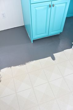 Learn how to paint a vinyl floor with this vinyl floor painting tutorial. See how a painted vinyl floor held up - years later - and see which products work best. Excellent flooring tutorial for a budget-friendly kitchen or bathroom makeover.