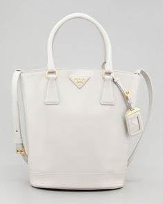 "Saffiano Vernice Bucket Bag, Talco by Prada at Bergdorf Goodman. Worn on Scandal episode 315 ""Mama Said Knock You Out."""