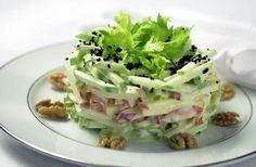 Originated at Waldorf Astoria New York,the WaldorfSaladis the single most frequently ordered recipe at the hotel from visitors around the world. The original version of apples and mayonnaise (the walnuts were added a bit later) dates back to the 1890s and is credited toOscar Tschirky, theWaldorf'sfamedmaître d'hôtel. Continuously served on all of the hotel restaurants' menus, roughly 20,000WaldorfSaladsare prepared every year. The recipe is always evolving and is interpr...