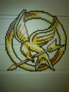 Mockingjay Pin - Perler or Hama by ~Chrisbeeblack on deviantART
