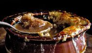 French Onion Soup broiled in the pot - use kitchen shears to snip the cheese into pieces for serving