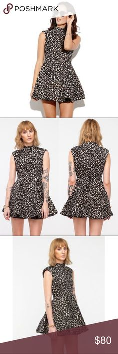Cameo Collective Luck Now Leopard Cheetah Dress Beautiful intricate detail leopard dress by Cameo.   C/Meo Collective brand sold at Revolve and Nasty Gal. Excellent quality material, sleeveless, hidden back zipper. Jacquard woven dress, flare skirt, High Neck, this dress was worn once. In excellent condition. Size small. $195 retail C/MEO Collective Dresses Mini