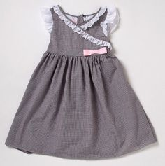 La Princess -Girls Sundress with Eyelet Trim in chocolate and milk.  Size 6 This extra-special dress can go from playtime to party time, thanks to its flouncy skirt, sweet ruffled accents and cute pair of coordinating bloomers. An elasticized design and breathable cotton material let her earn her diva stripes while staying uber-comfy!      62% Polyester, 38% cotton     Machine wash cold, tumble dry low     Imported