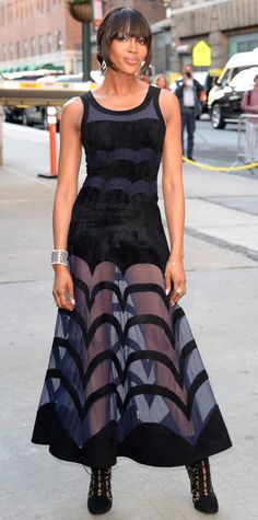 Naomi Campbell flaunted her supermodel legs at the amfAR Inspiration Gala in a navy-and-black graphic gown with a sheer-paneled skirt, finishing her look with Lorraine Schwartz diamonds and black lace booties.