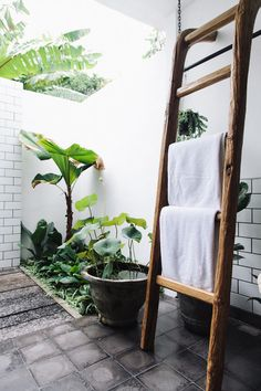 Outdoor shower / bathroom and rustic ladder. Exotic meets boho in a Bali pool villa / Fella Villa.