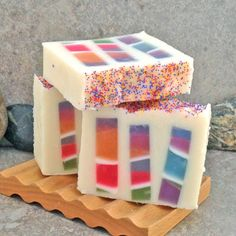 "Over the moon thrilled with how this new design soap experiment came out. I call this my ""Stained Glass Soap"". The inner multi-colored striped pieces were created first with translucent glycerin soap then cut into long pieces and embedded into the cold process base. Scented with Lemongrass Sage fragrance with a dusting of multi-colored jojoba beads on tops. Love it!!  By Alaiyna B. Bath and Body."