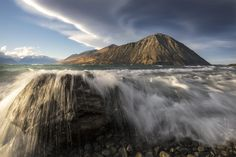 Fierce winds stir up glacial waters and an amazing lenticular cloud that slowly built in size and density, above Lake Ohau and the Ben Ohau range.