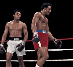 """Muhammad Ali stares down George Foreman during their 1974 """"Rumble in the Jungle"""" in Zaire. Ali won by knocking out Foreman in the eighth round. (Neil Leifer/SI)  GALLERY: Rare Muhammad Ali Photos