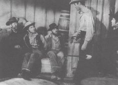 Mark Stevens and Joel McCrea star in the 1957 Allied Artist picture, Gunsight Ridge. Steve Mitchell (center) and L.Q. Jones were also featured.