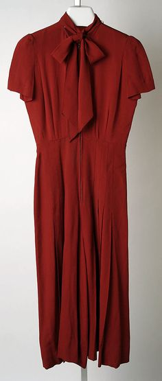 Red silk evening dress with pussycat bow tie, by Norman Norell, American, 1942.