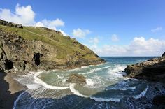 Merlin's Cave at low tide - beneath Tintagel Castle, Cornwell UK