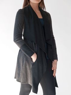 Striking knit and tencel gray/black Jacket. A modern, flattering style. Beautifully draped Tencel collar. Soft Ponte Roma knit moves with ease and comfort. Urban and sophisticated, yet fun. By Erin Draper.