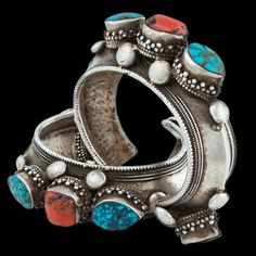 Studded with fortune bringing chunks of coral and protective turquoise this cuff employs a particular method in its manufacture that is very difficult to achieve even for an experienced silversmith. That is to form the curvacious ridge across the back while beating the silver gently from each side. Beautiful! |Tibetan Silver Turquoise and Coral Cuff| Darjeeling| India| Circa Mid 20th Century| Wrist Dia 6.6cm| 131g| (Pair Available)| £800 each. www.rabari.co.uk