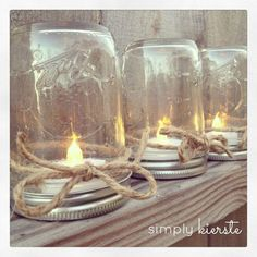 Upside down jars with a twine bow, make perfect tealight holders. (Note: These are battery-operated tea lights; if you use real ones, you need a hole drilled somewhere to allow oxygen to come in; otherwise it will almost immediately extinguish itself.)