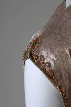 Evening dress, ca. 1938. Silk brocade, glass beads, and coral trim. Mainbocher, France. Gift of Mrs. A. Watson Armour III. 1959.348