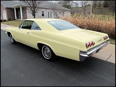 1965 Chevrolet Impala SS.  Had one exactly like this - even the same color.