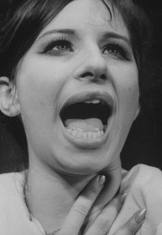 Her face when she sings is just so not vocally correct or anything and I TOTALLY admire the way it changes her sound and makes her unique. She never needed to be taught how to sing. She created her own style with that wonderful loud voice. I am in <3