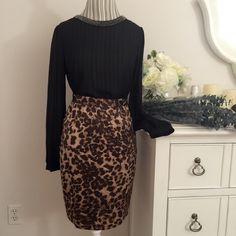CLUB MONACO Size 2 leopard skirt NWT CLUB MONACO Gorgeous high waisted 'Jackie' leopard print skirt. Size 2 brand new with tag 100% polyester. Feels like a silk. zipper in back. Club Monaco Skirts Midi