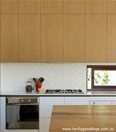 "The pressed tin design called ""Original"" was used as a feature splashback in this trendy kitchen."