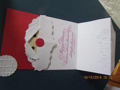 Santa card with sentiment tuck up under bis beard under his Mustache. Used embossing folders and  circle punches.